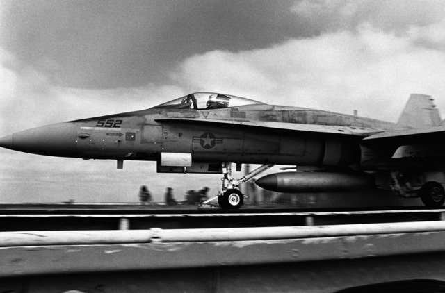 Left side view of an F/A-18 Hornet aircraft on the catapult preparing for takeoff from the aircraft carrier USS CONSTELLATION (CV 64) during an operational evaluation (OPEVAL)