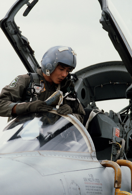 A Royal Thai Air Force pilot exits an aircraft upon landing during the joint Exercise COPE THUNDER '84