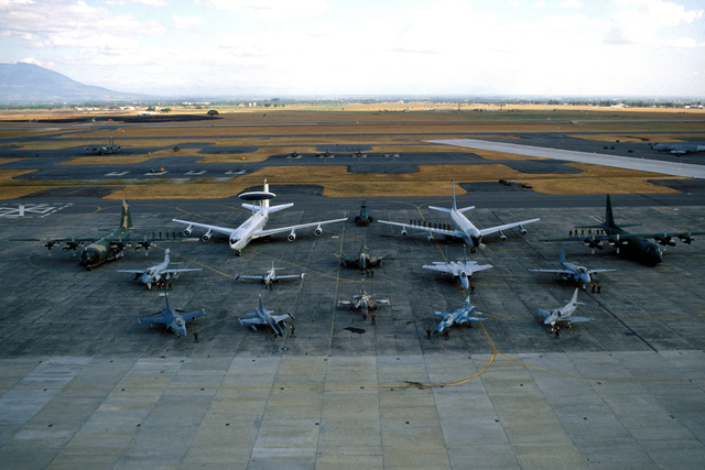 Participates of Exercise COPE THUNDER '84, including the Royal Thai and Philippines Air Forces, stand by their respective aircraft on the flight line at the conclusion of the exercise