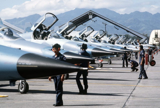 Royal Thai Air Force F-5E Tiger II aircraft undergo pre-flight maintenance on the flight line during the joint Exercise COPE THUNDER '84