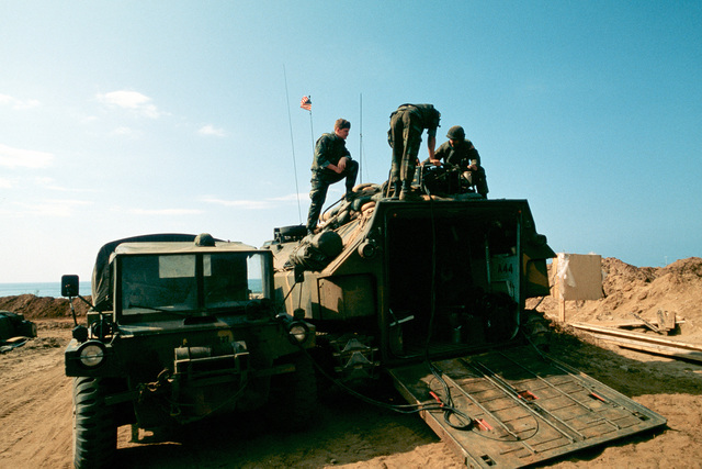 Marines from the 22nd Marine Amphibious Unit perform maintenance on an LVTP 7 armored amphibious assault vehicle during a multinational peacekeeping operation