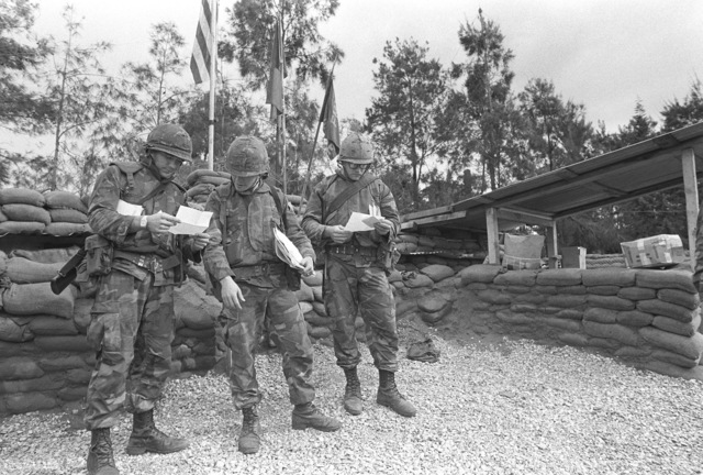 Members of Echo Co., 22nd Marine Amphibious Unit, read their mail prior to redeployment back to ships of Amphibious Squadron 4, at the conclusion of a multinational peacekeeping operation
