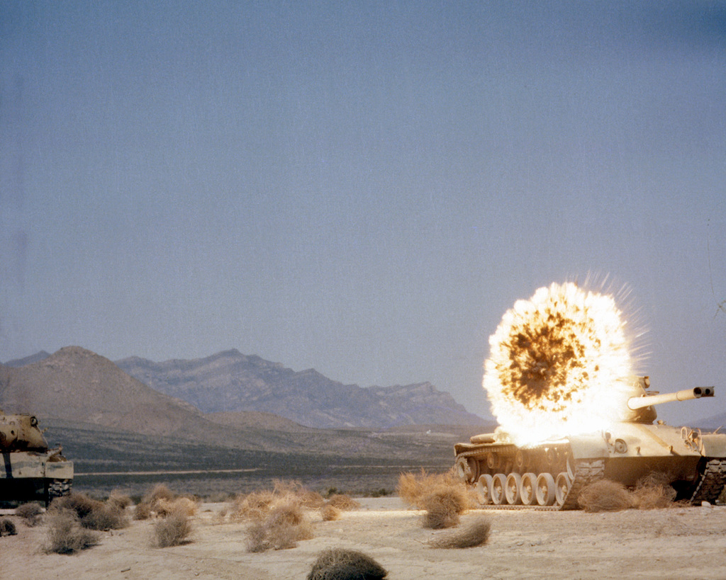 A Copperhead laser-guided anti-tank missile fired from a towed M-198 155mm howitzer explodes on a target tank
