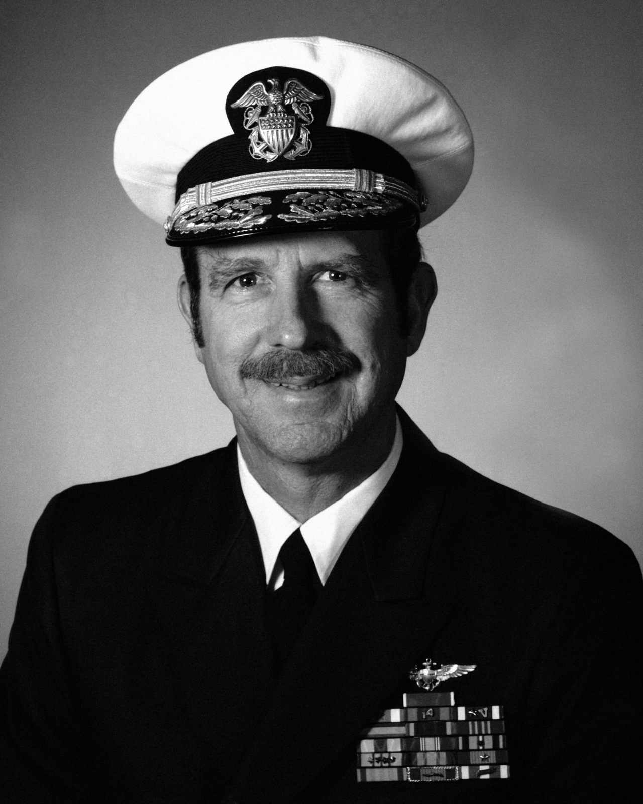 Commodore Denis T. Schwaab, USN (covered)
