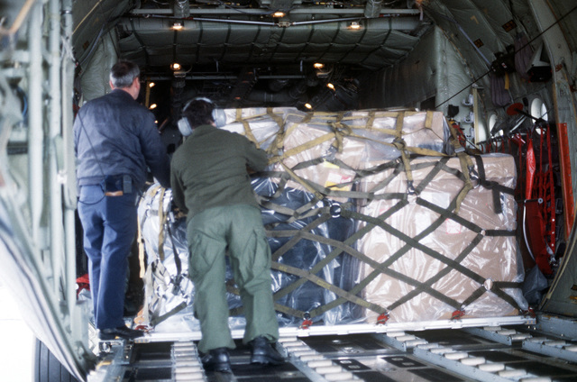 Members of the 144th Tactical Airlift Squadron (TASq), Air National Guard, load supplies aboard a C-130 Hercules aircraft. The 144th TASq is en route to Howard Air Force Base, Panama, to participate in Operation VOLANT OAK