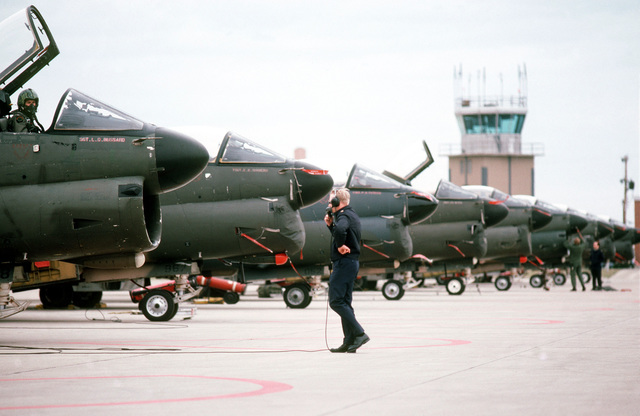 A right front view of an A-7D Corsair II aircraft on the flight line at Springfield Municipal Airport as members of the 178th Tactical Fighter Group, Ohio Air National Guard, prepare them for takeoff