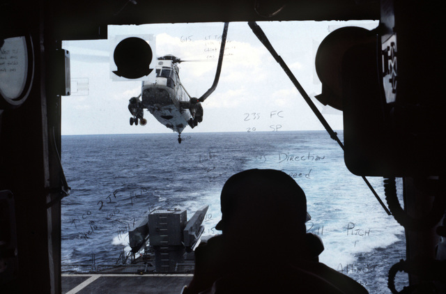 A view from the air boss's perch as an SH-3H Sea King helicopter approaches the landing pad aboard the guided missile curiser USS TICONDEROGA (CG 47)