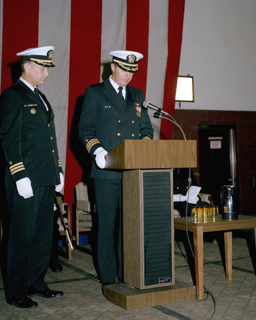 Commander (CDR) David S. Wilder reads his orders during a Change of Command Ceremony in Hangar Seven. CDR Wilder is relieving CDR Kent Parsons as Commanding Officer of Fleet Logistics Support Squadron 61 (VR-61)