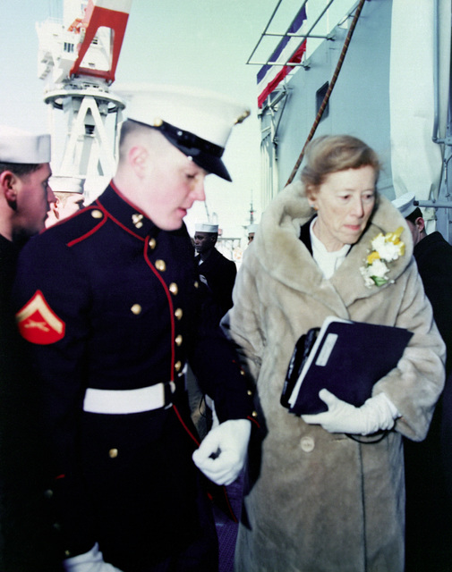 Elizabeth M. Tryon, sponsor, is escorted to her seat for the commissioning of the guided missile frigate NICHOLAS (FFG-47)