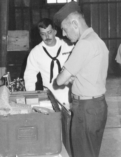 Lieutenant General (LGEN) George B. Crist, vice director, Joint Office of the STAFF, Joint CHIEF of STAFF, inspects a mount out of medical supplies during his tour of the Marine Corps Logistic Base