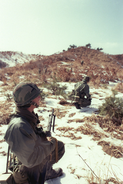 Members of Company B, 1ST Battalion, 25th Infantry Division, participate in live-fire training near Chunchon during the joint South Korean/US training Exercise TEAM SPIRIT '84. The soldier in the foreground is armed with an M60 machine gun