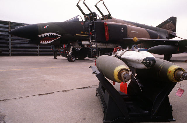 A bomb rack with two Mark 82 bombs is ready to be loaded on an F-4 Phantom II aircraft during the joint US/South Korean Exercise TEAM SPIRIT '84