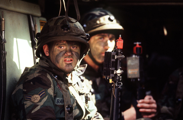 STAFF Sergeant George Roberts, Training NCO for the 8th Members of the 8th Security Police Squadron Air Force Base Ground Defense Team seated in an armored personnel carrier during the joint US/South Korean Exercise TEAM SPIRIT '84. They are wearing multi