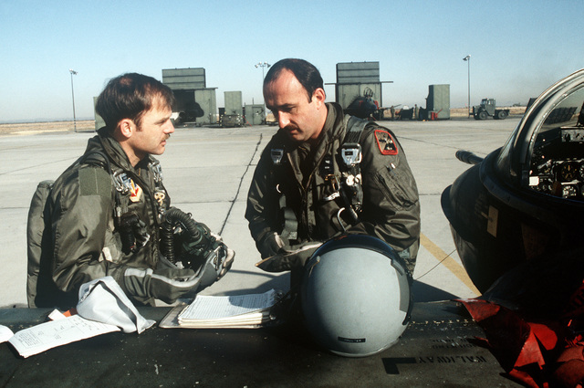 A-37 Dragonfly aircraft pilots discuss the flight plan prior to boarding their aircraft during Exercise AIR WARRIOR