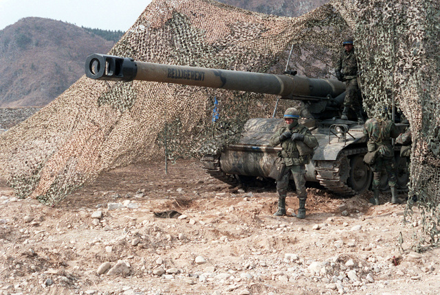 US Army personnel self-propelled howitzer in a river bed during the joint South Korea/US Exercise Team Spirit '84