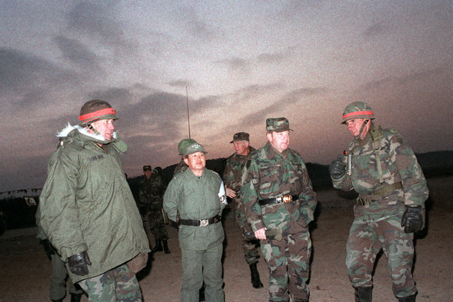 Officers of the US and South Korean armies observe an early morning crossing of the Han River by soldiers of the 2nd Battalion, 25th Infantry Division, during the joint South Korean/US training Exercise TEAM SPIRIT '84. They are Major General W.H. Schneider, left, a South Korean army general, General (GEN) Robert W. Senrewald, center, and Brigadier General (BGEN) John T. Quinn