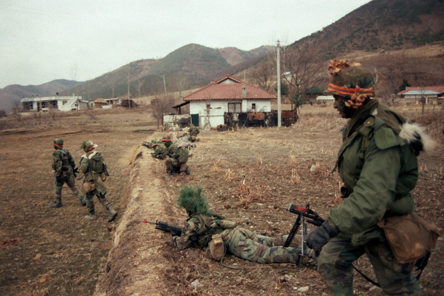 Members of Company A, 1ST Battalion, 14th Infantry, 25th Infantry Division (Orange Forces), battle the Blue Forces along Highway 43 during the joint South Korean/US training Exercise TEAM SPIRIT '84