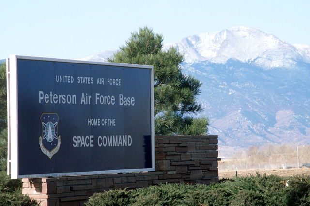 A sign at the entrance to Peterson Air Force Base, home of the US Air Force Space Command and the North America Air Defense Command (NORAD) Cheyenne Mountain Complex
