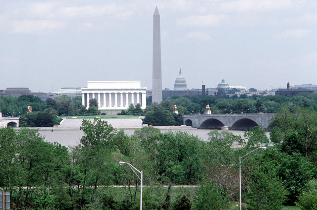 A view from across the Potomac River of the Lincoln Memorial, Washington Monument and United States Capitol