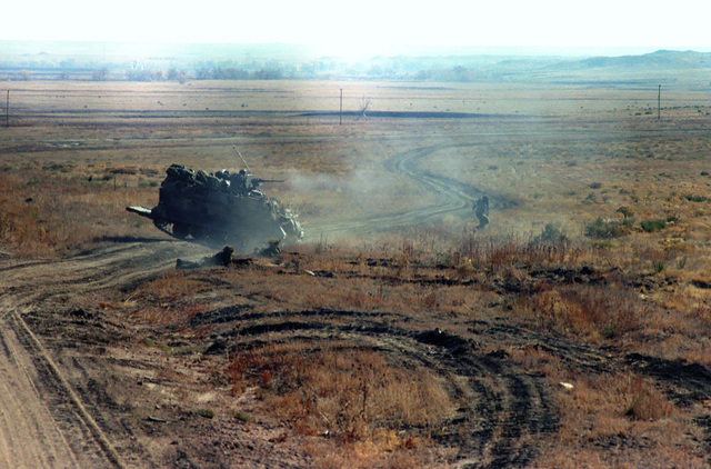 An M-113 armored personnel carrier on maneuvers during a downrange training exercise