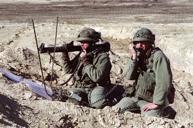 Members of Company B, 1/77 Armor, aim a Viper light anti-tank weapon during a downrange training exercise
