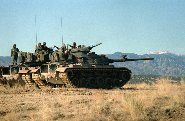 Personnel and M-60 Main Battle Tanks of Company B, 2nd Brigade, 1/77 Armor, participate in a downrangetraining exercise