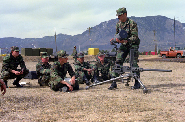 Personnel of the 1/11th Infantry, 4th Infantry Division, are instructed in the use of a night vision sight on an M2, .50 caliber machine gun