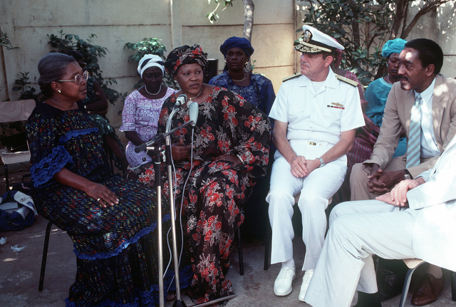 Rear Admiral Clinton W. Taylor, commander South Atlantic Force, visits with the women of the Senegalese Women's Association. PHOTO from April 1984 All Hands Magazine