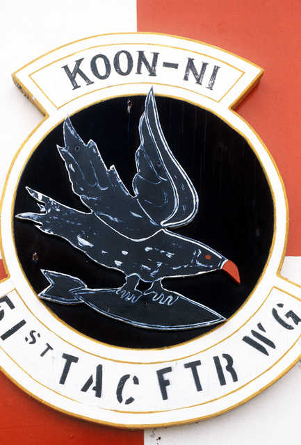 The emblem for the Koon-Ni GUNNERY and Bombing Range operated by the 51st Tactical Fighter Wing. AIRMAN Magazine, April 1984