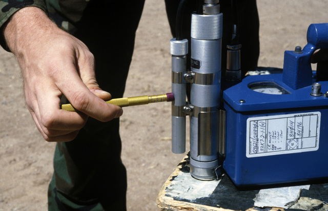 A pre-operational check is performed on a PDR-27 monitoring device during a Nuclear Emergency Team exercise at the Nuclear Weapons School