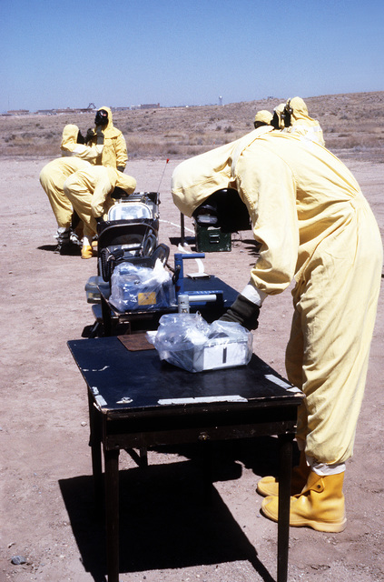 MASTER SGT. James Holcomb, wearing nuclear biological chemical (NBC) protection gear, monitors for Alpha radiation using a PDR-56 detection device, during a Nuclear Emergency Team exercise at the Nuclear Weapons School
