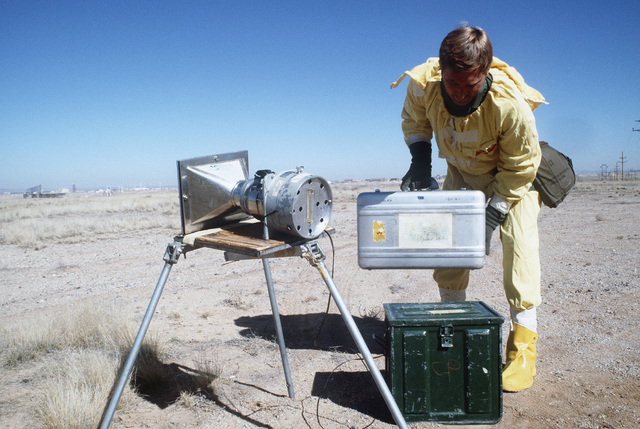 Technical Sergeant (TSGT) Dana Blish, wearing nuclear-biological-chemical (NBC) protective gear, monitors a wind staplex during a Nuclear Emergency Team exercise at the Nuclear Weapons School