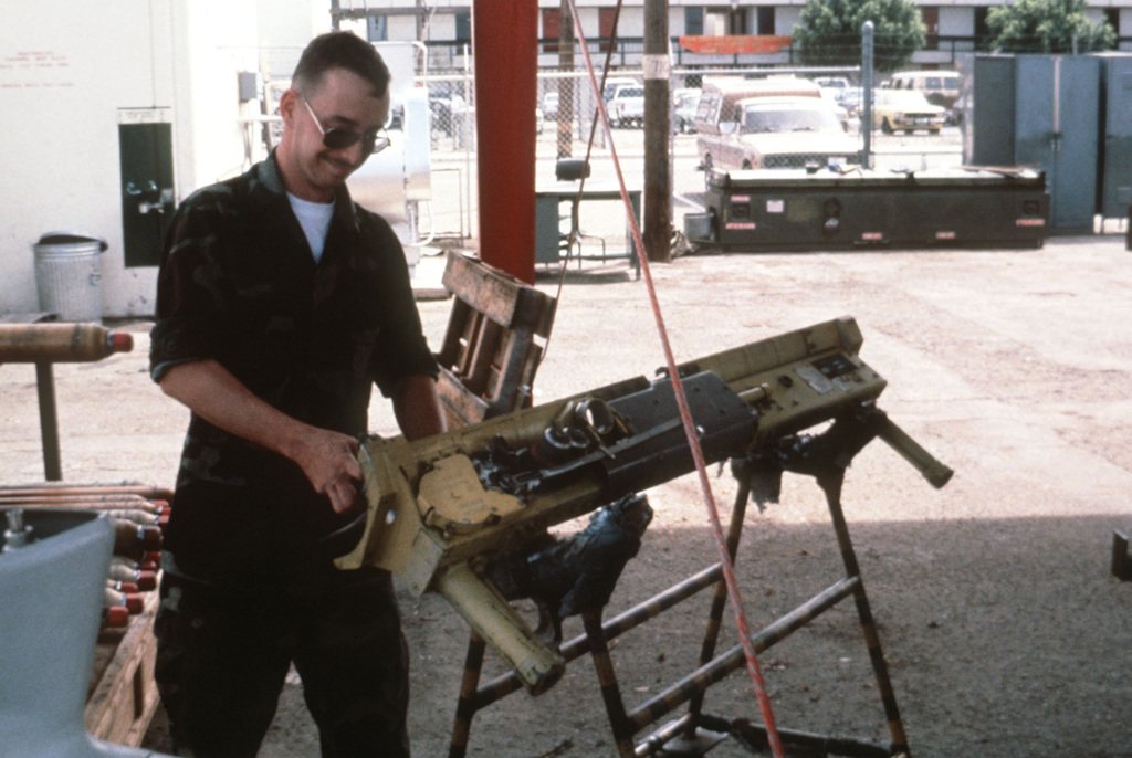 Sergeant Carter of the Aircraft Intermediate Maintenance Department (AIMD) armament section services an Aero-7A missile launcher