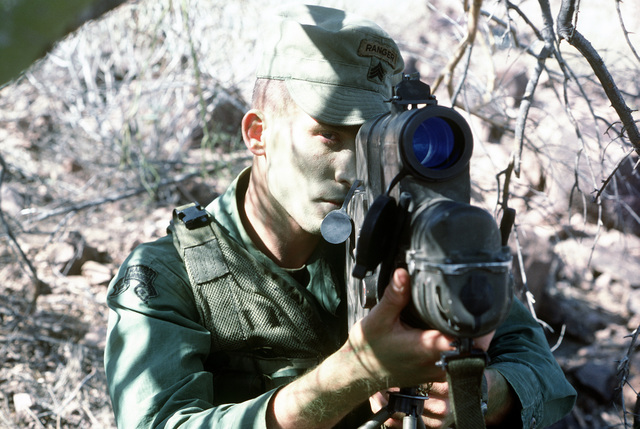 An Army Ranger sets up an AN/PAQ-1 laser target designator during Exercise QUICK FORCE 84-3. The laser projector will be used to assist A-7 Corsair II pilots as they drop laser guided bombs on designated targets
