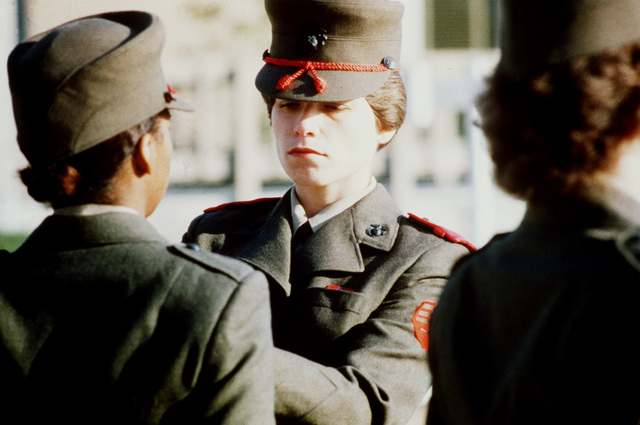 A drill instructor from the Woman Recruit Training Command conducts a personal appearance inspection during basic training