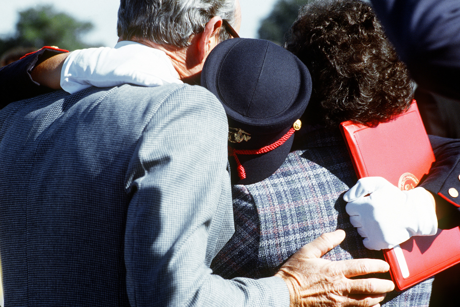 A recruit from the Woman Recruit Training Command embraces loved ones upon graduating from basic training