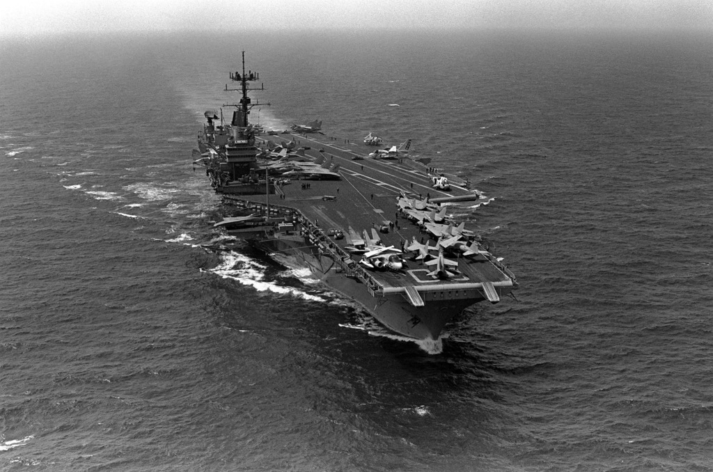 A starboard bow view of the aircraft carrier USS SARATOGA (CV 60) underway during operations with the 6th Fleet