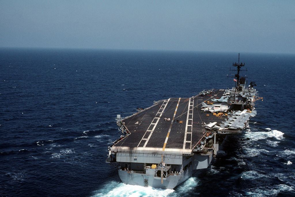 A starboard quarter view of the aircraft carrier USS SARATOGA (CV 60) underway during operations with the 6th Fleet