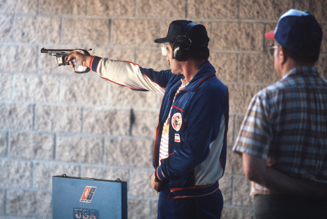 A US team member competes in a rapid fire pistol event during the Olympic Shooting Range Inaugural Competition. The international competition is serving as a test of the facility prior to the 1984 Olympic Games