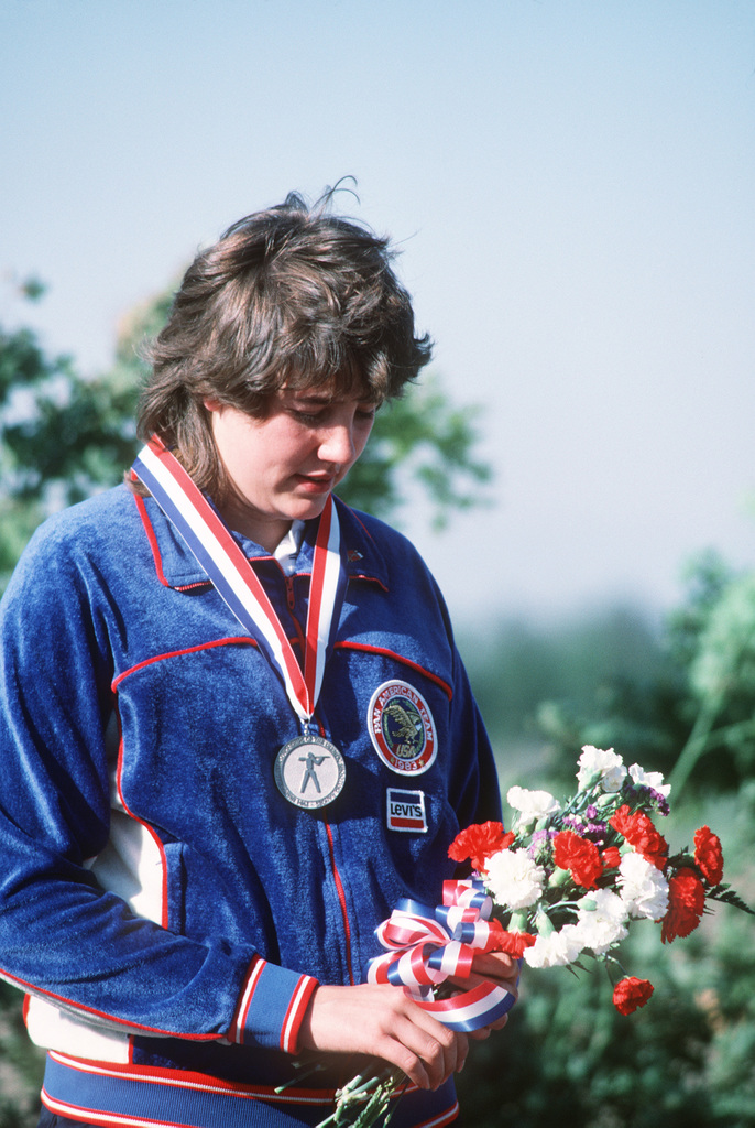 Pat Spurgin poses for a photo with the silver medal she won in the women's three-position small-bore rifle event of the Olympic Shooting Range during Inaugural Competition. The international competition is serving as a test of the facility prior to the 1984 Olympic Games