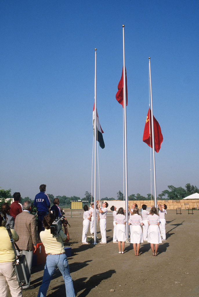 The flags of the winner's countries are raised following medal presentations at the Olympic Shooting Range during Inaugural Competition. The international competition is serving as a test of the facility prior to the 1984 Olympic Games