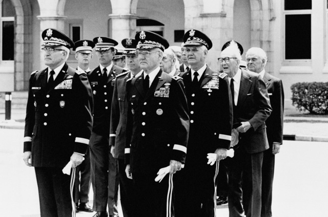 Classmates and fellow officers are gathered at the funeral services for he retired General Mark Clark, US Army, at The Citadel Military Academy. Front row, left to right: General (GEN) B. Rogers, supreme allied commander, Europe; retired Major General J.A. Grinsley, US Army, president of the Citadel; and retired GEN William Westmoreland, US Army, former Army CHIEF of STAFF