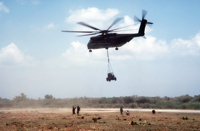 A CH-53E Super Stallion helicopter airlifts heavy equipment during Exercise OCEAN VENTURE '84