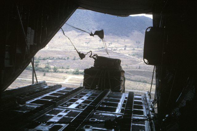 A container delivery system (CDS) drop from a C-130 Hercules aircraft takes place during Operation OCEAN VENTURE '84
