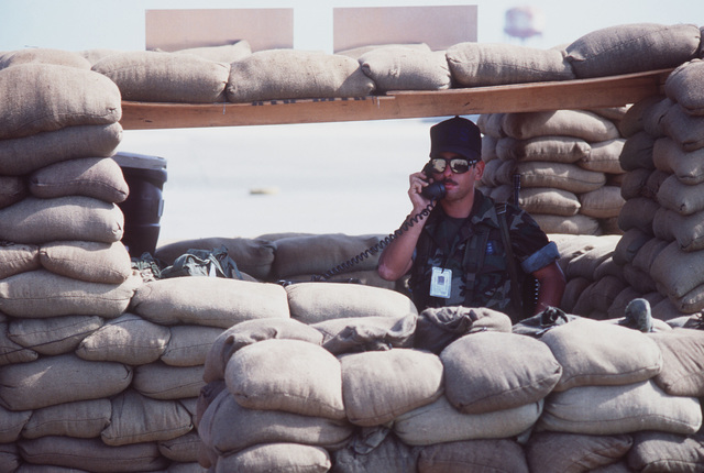 AIRMAN 1ST Class Glenn Gallegos, 27th Security Police Squadron, guards the perimeter from a sandbag-fortified position during Operation OCEAN VENTURE '84