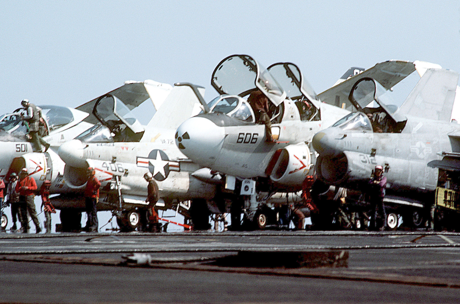 Among the aircraft parked on the flight deck of the aircraft carrier USS AMERICA (CV 66) during Exercise OCEAN VENTURE '84 are (left to right) an A-6E Intruder, an A-7E Corsair II, an EA-6B Prowler and another A-7E