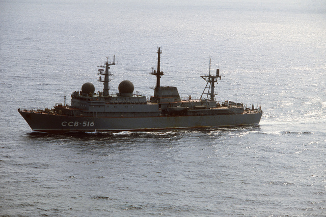 An aerial port beam view of a Soviet Balzam class intelligence collector ship (AGI) underway near Puerto Rico, where US forces are participating in Operation OCEAN VENTURE '84