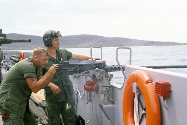 Members of the 3rd Platoon, Company B, 82nd Airborne Division, aboard an Army utility landing craft, conduct offshore firing at targets on Viegues Island using a 50-cal. M2 Browning machine gun during Operation OCEAN VENTURE '84