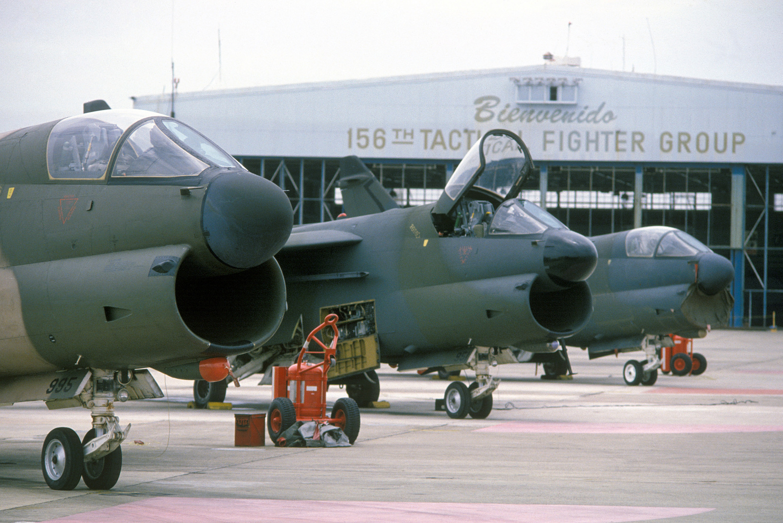 Right front view of three A-7D Corsair II aircraft assigned to the 156th Tactical Fighter Group, Munez Air National Guard Base, as they undergo pre-flight maintenance during Operation OCEAN VENTURE '84
