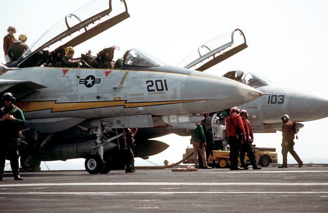 Two F-14A Tomcat aircraft are serviced aboard the aircraft carrier USS AMERICA (CV 66) during Exercise OCEAN VENTURE '84